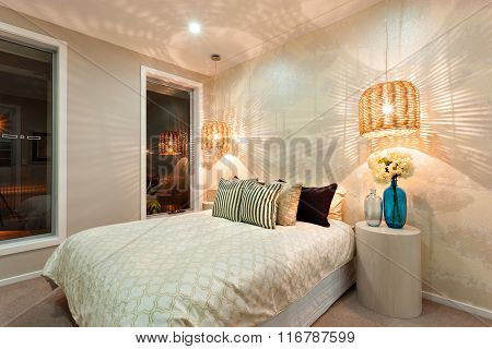 Side View Of A Luxurious Bedroom With A King Size Bed And A Swirling Pattern Of A Light