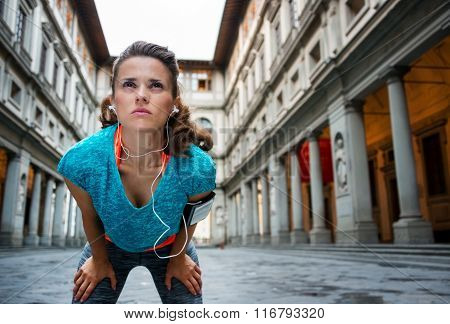 Sporty Woman Catching Breath In Front Of Uffizi Gallery