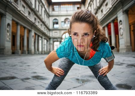 Young Concentrated Sportswoman Is Catching Breath