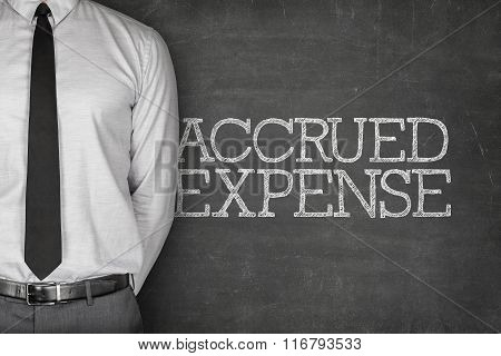Accrued expense text on blackboard