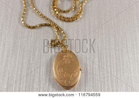 Golden antique locket