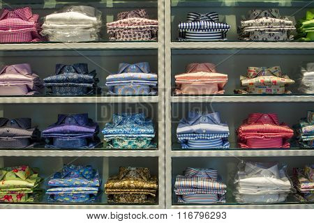 Neat stacks of folded clothing on the shop shelves