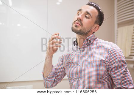Man Using Perfume Before Date