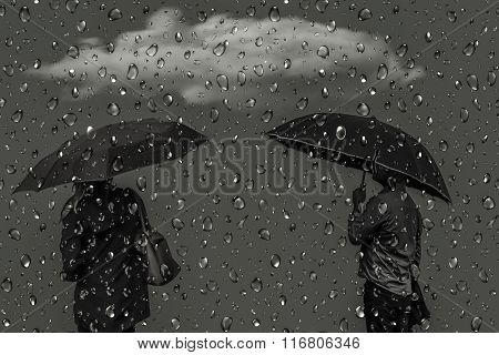 Silhouettes Of Men And Women Under Umbrellas