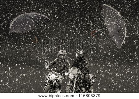 Through Snow And Rain Rushing Two Motorcyclists