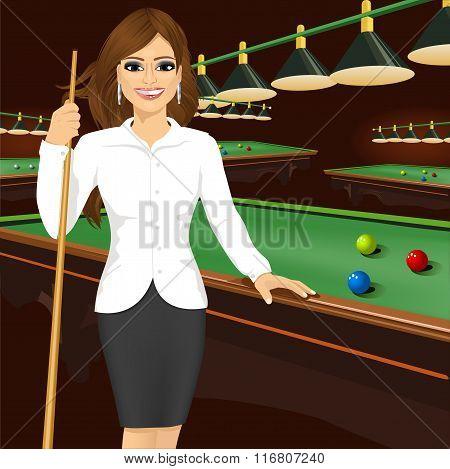 beautiful business woman holding cue stick