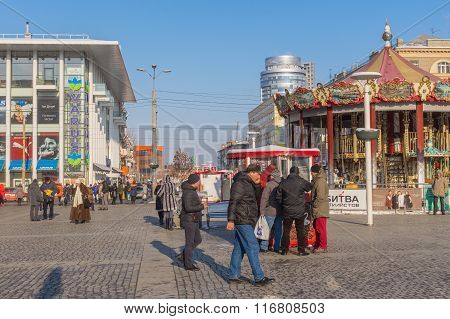 Central square of the Dnepropetrovsk city with many people at workday