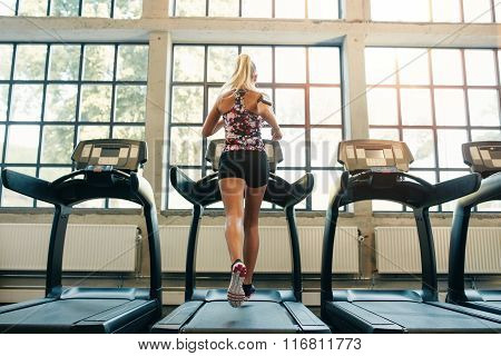 Woman Jogging On Treadmill