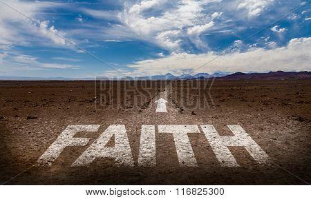 Faith written on desert road