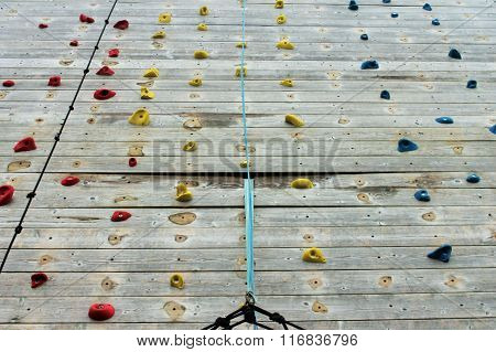 Wooden Climbing Wall With Bright Colored Foot Holds
