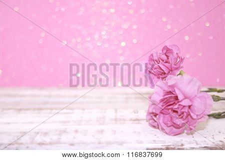 Pink Carnation Flowers On Rustic White Wooden Table. Valentine's Day And Mother's Day Background. To