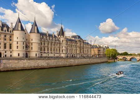 View of Conciergerie - former prison and part of former royal palace on the bank of Seine river in Paris, France.