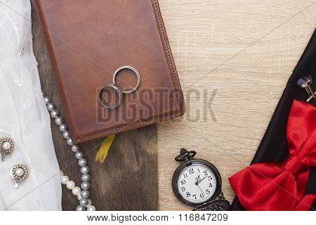 Wedding Rings On A Book Bound In Leather