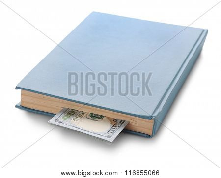 Blue book with nested dollar banknotes, isolated on white. Stash of money