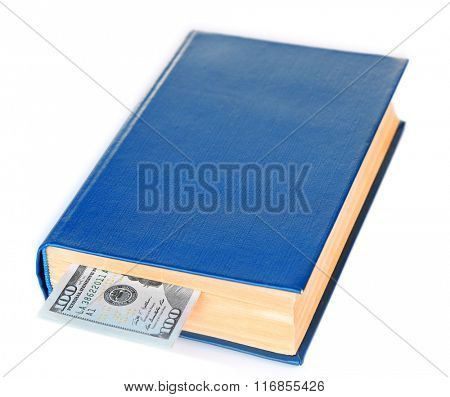 Blue book with nested dollar banknote, isolated on white. Stash of money