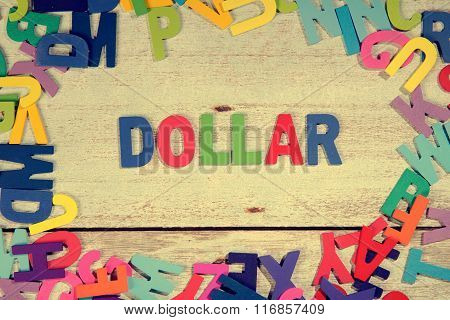 Dollar Word Block Concept Photo On Plank Wood