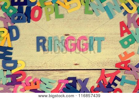 Ringgit Word Block Concept Photo On Plank Wood