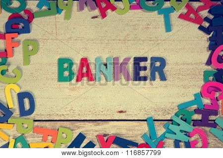 Banker Word Block Concept Photo On Plank Wood