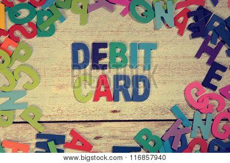 Debit Card Word Block Concept Photo On Plank Wood