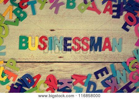 Businessman Word Block Concept Photo On Plank Wood