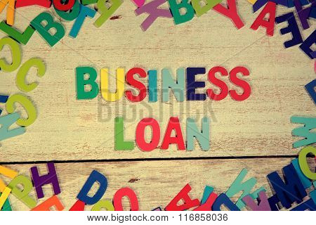 Business Loan Word Block Concept Photo On Plank Wood