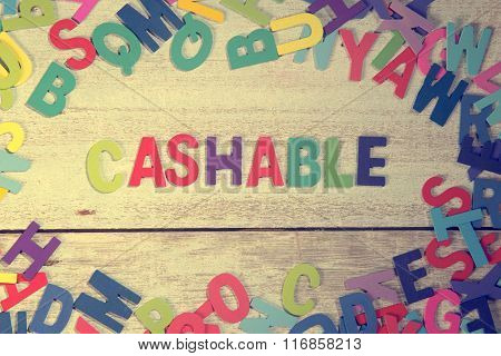 Cashable Word Block Concept Photo On Plank Wood