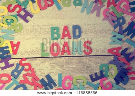 Bad Loans Word Block Concept Photo On Plank Wood