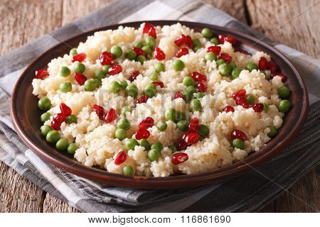 Dietary Food: Cous Cous With Green Peas And Pomegranate. Horizontal