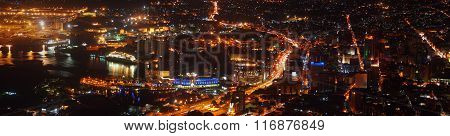 Panoramic view of a capital city by night