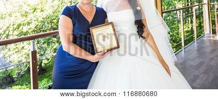Bride's mother blessing her before  wedding ceremony