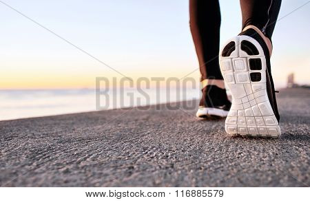 Athlete Runner Feet Running On Treadmill Closeup On Shoe. Jogger Fitness Shoe In The Background And