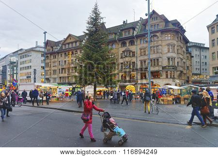 BASEL SWITZERLAND - JANUARY 1 2014: Street view of Marktplatz in the Old Town of Basel. Basel is a third most populous city in Switzerland. It is located on the river Rhine.