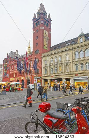 BASEL SWITZERLAND - JANUARY 1 2014: Street view of Town Hall in the Marktplatz in Basel. Basel is a third most populous city in Switzerland. It is located on the river Rhine.