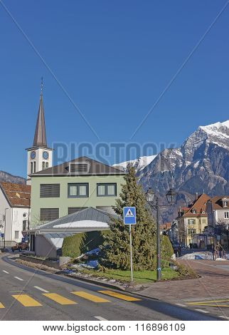 Catholic Church in the Old Town of Bad Ragaz. Bad Ragaz is a city in canton St. Gallen in Switzerland. It lies over Graubunden Alps. Spa and recreation village is at end of Tamina valley poster