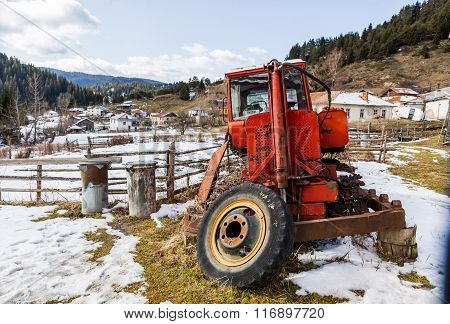 Broken And Abandoned Tractor In Mountain Fields, Nostalgia Concept