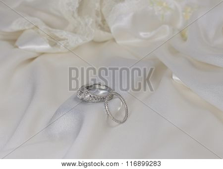 Diamond wedding and engagement rings on Satin and Lace