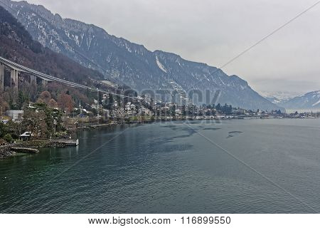 Long bridge above Montreux and Lake Geneva in winter. Montreux is a city in the canton of Vaud in Switzerland. It is located on Lake Geneva at the foot of the Alps.