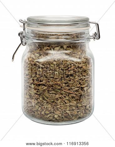 Dried Oregano Leaves In A Glass Canister