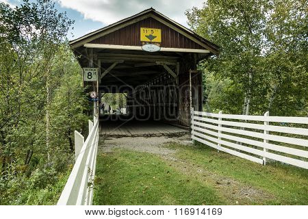 An historic covered bridge in Quebec Canada