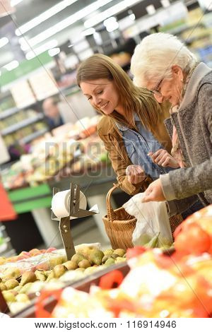 Elderly woman with young woman at the grocery store