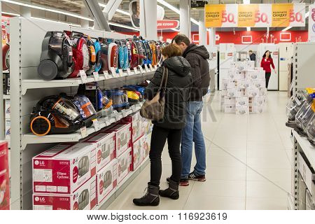 Moscow Russia - February 02. 2016. Customers choose a vacuum cleaner in Eldorado is large chain stores selling electronics and household appliances