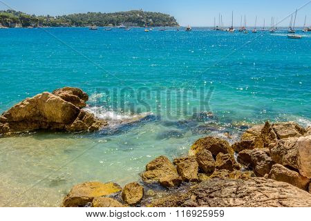 View of luxury resort Villefranche-sur-Mer and bay on French Riviera at Mediterranean Sea. Cote d'Azur. France. Villefranche-sur-Mer adjoins city of Nice to the east and 10 km south west of Monaco.