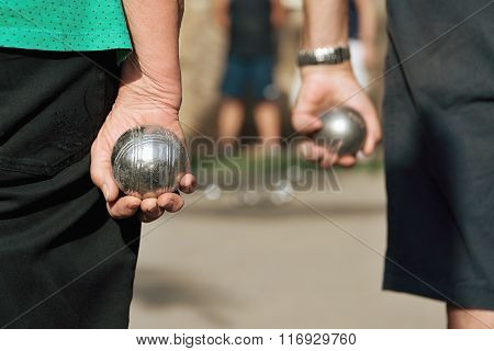 seniors playing the french game petanque
