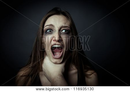 Home Violence - Young Woman Is Choked By Man's Hand, Close Up Photo