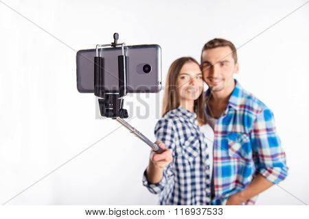Happy Couple In Love Making Photo With Selfie Stick