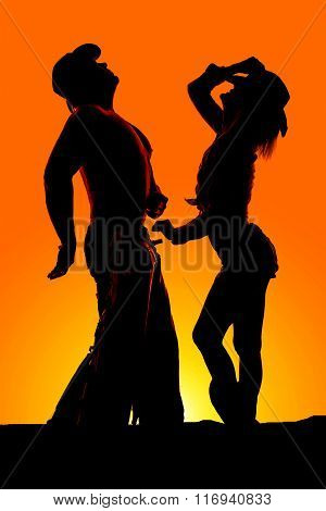 Silhouette Of Woman Stand By Cowboy Both Look Up