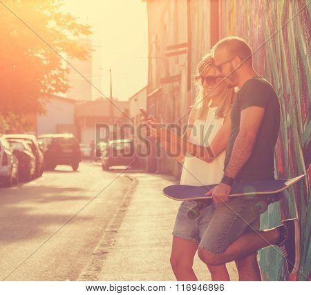 Urban couple outdoors.