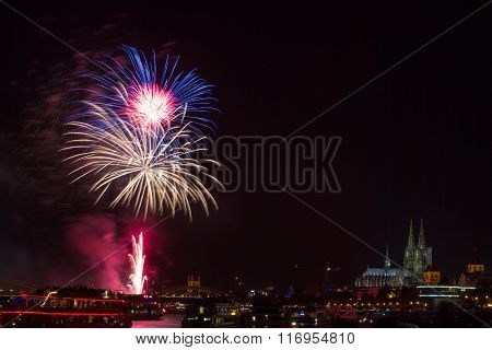 Colourful firework in front of the cathedral of Cologne Germany