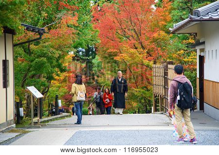 Japanese Monk At Eikando Temple With Autumn Color