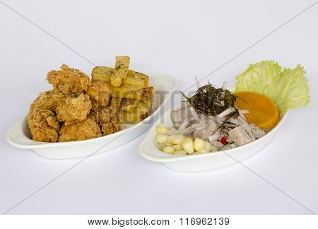Peruvian food: chicharrones de pescado with ceviche (cebiche). Fried fish and ceviche.